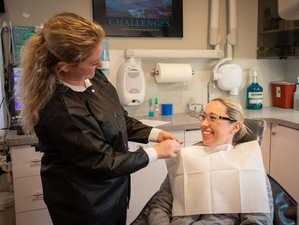Dental Hygienist talking to the patient about dental procedure