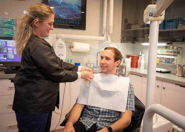 Dental Hygienist talking to the patient