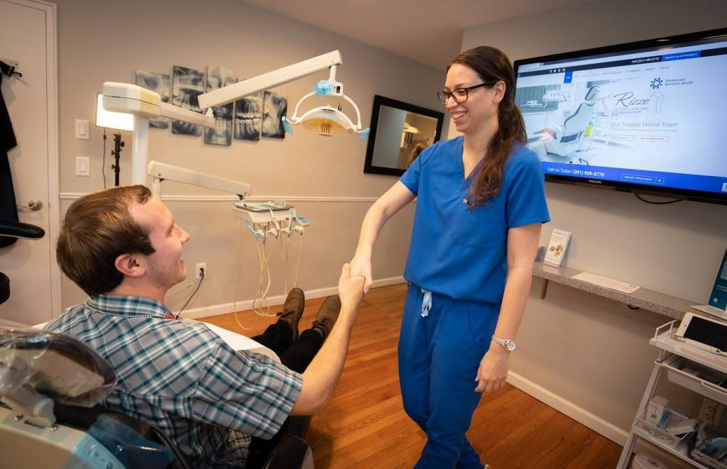 Patient admiring Dental Hygienist for the treatment
